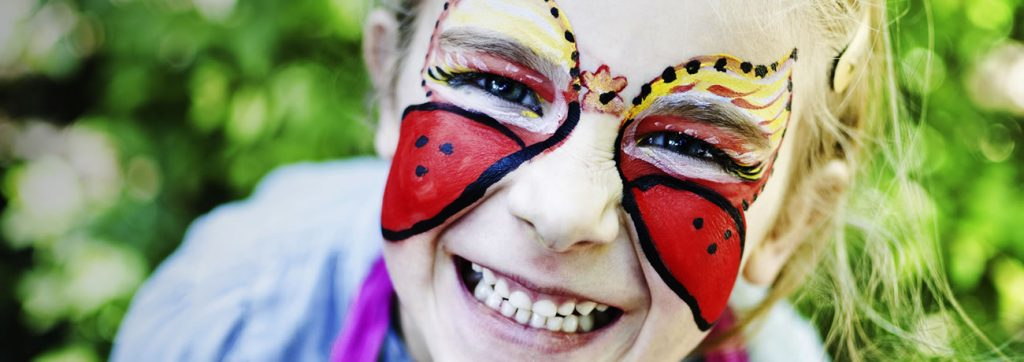 Girl smiling with face paint